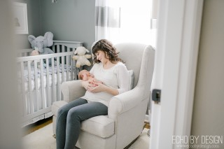 Lifestyle Newborn Photo of Mom in Rocking Chair with Baby